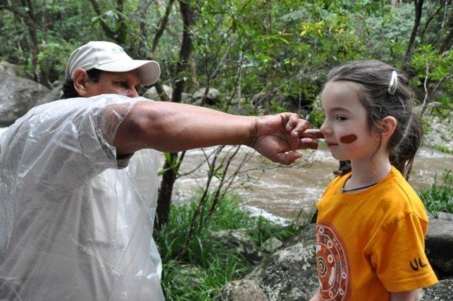 Ivy facepaint in Mossman River in Far North Queensland