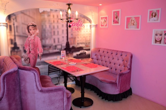 Vintage Barbie watching over the booths at Barbie cafe