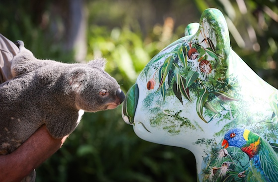 At Billabong Zoo, Port Macquarie - artist Bruce Whittaker with his painted Hello Koala and a real koala! Image: Lindsay Moller/Billabong Zoo