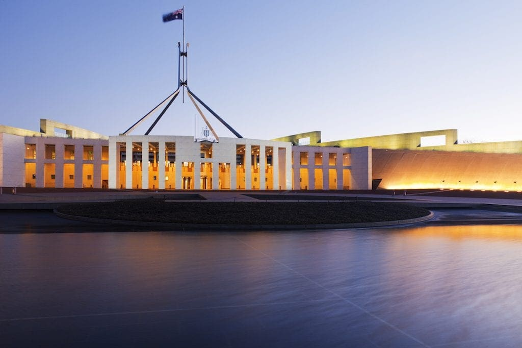 Parliament House, Canberra, Australia, illuminated at twilight. Reflections in pool, Australian flag is flying. For MANY MORE Australian images, please click [url=http://www.istockphoto.com/file_search.php?action=file&lightboxID=3095916]here[/url].