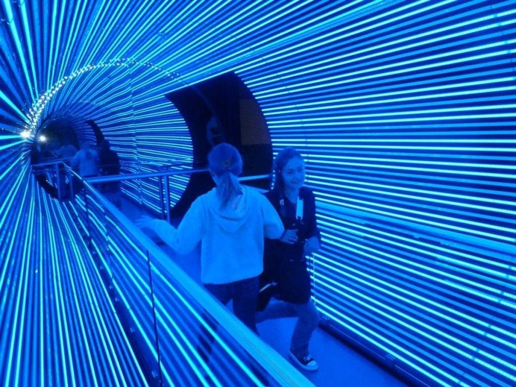 Kids inside blue optical illusion tunnel