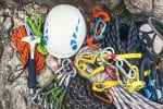 A collection of ropes, helmet and abseiling equipment