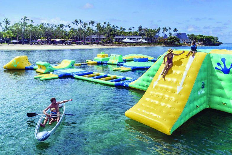 A family enjoying the waterpark at Shangri La Fijian Resort and Spa