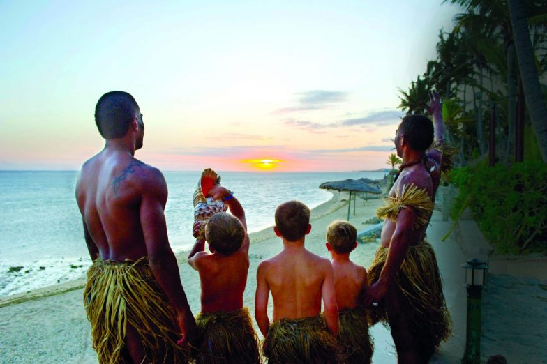 Children blowing conch shells at Outrigger Fiji Beach Resort Picture Outrigger Hotels and Resorts