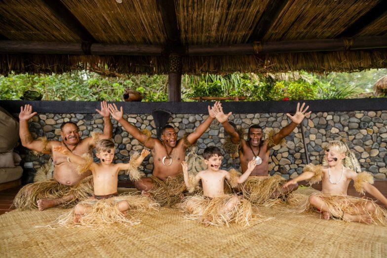 Children with warriors at Nanuku Auberge Resort