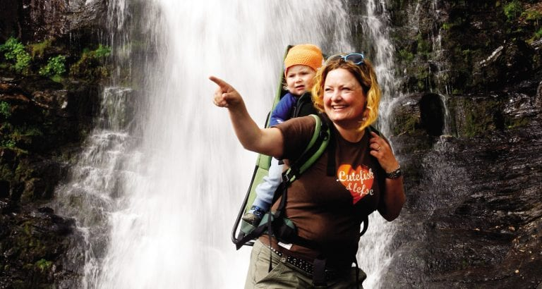 FEATURE A woman and a child at a waterfall at Hemsedal in Norway Image Nils Erik Bjørholt Visitnorway com