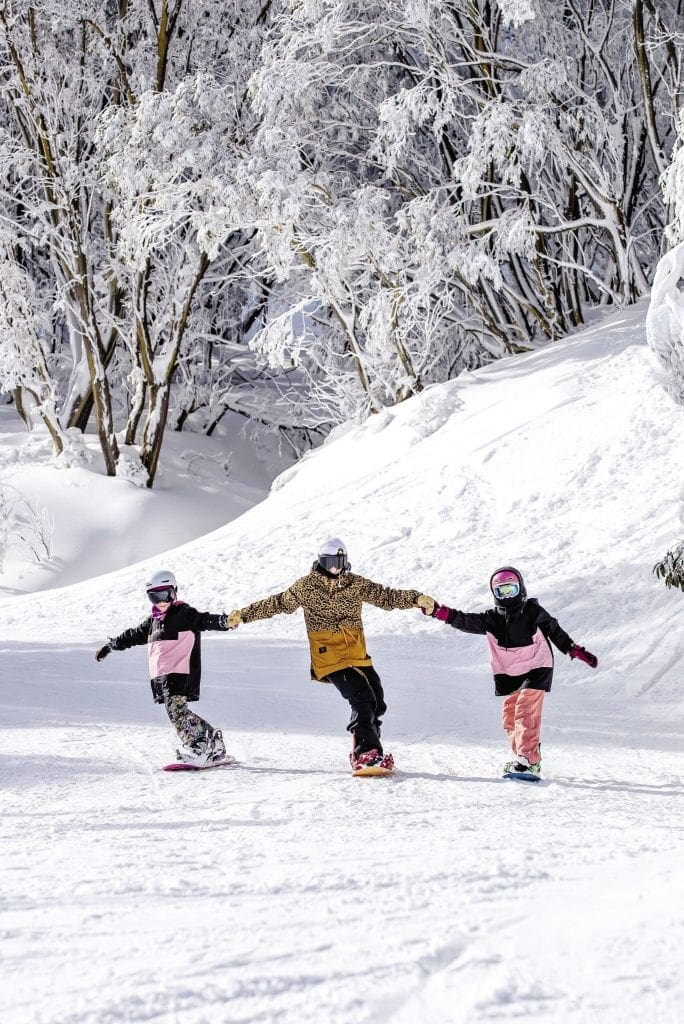Kids snowboarding at Falls Creek Ski Resort
