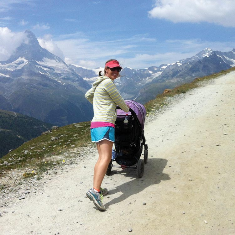 Flip Byrnes pushing her daughter in a pram in St Gervais France
