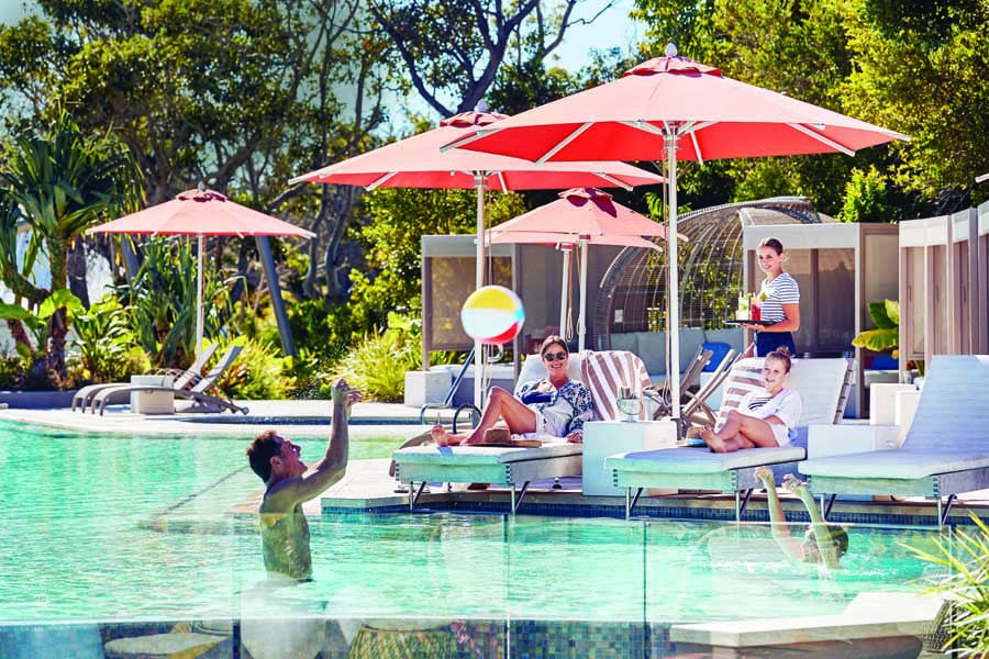 a family enjoying the lagoon pool at elements of byron
