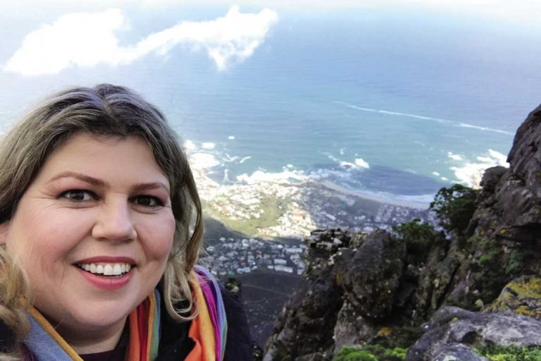 feature admiring the view from the top of table mountain