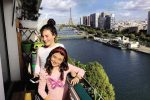feature mila and freya on the balcony of their paris apartment