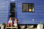 feature the kids on the steps of the tiny house at walden in nsw