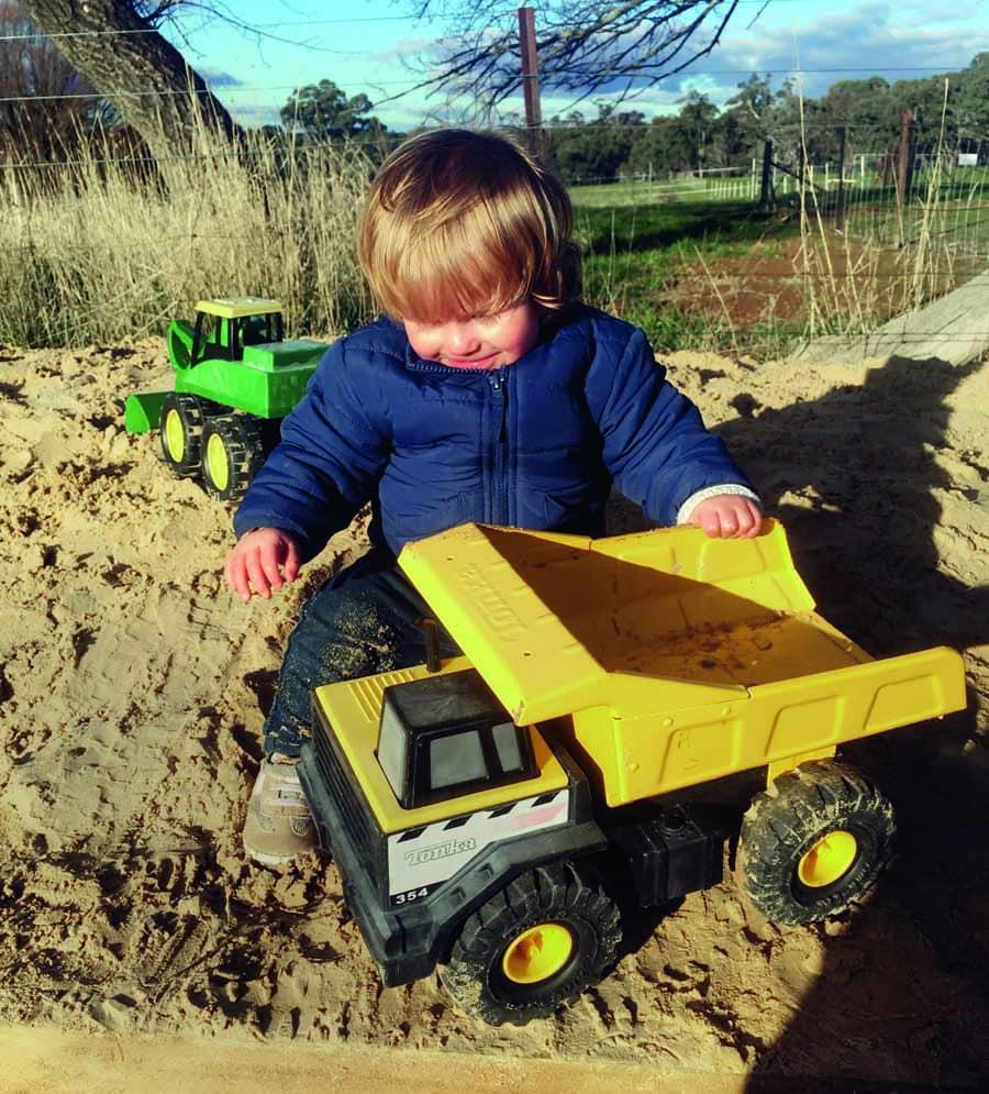 oliver playing in the sandpit at heifer station wines