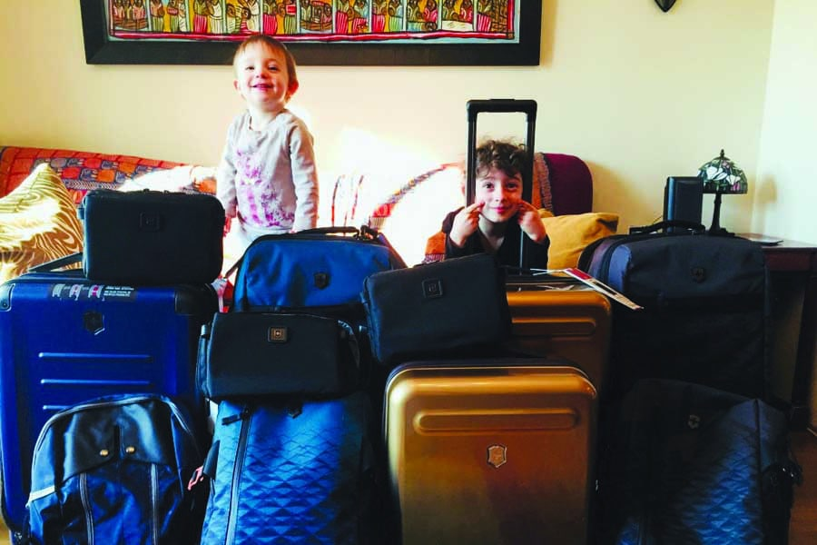 the kids with the luggage. image robin esrock
