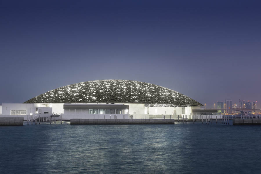 the louvre abu dhabi at night. image mohamed somji