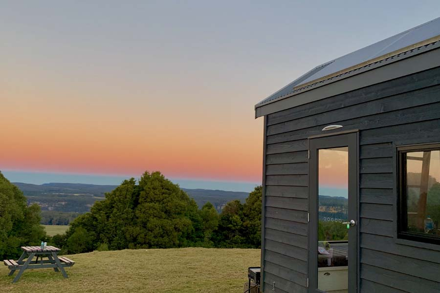 the sunset view from the tiny house at edmond in nsw