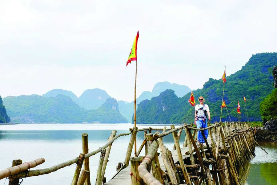 walking across the cat ba island bridge. image kyle rodriguez