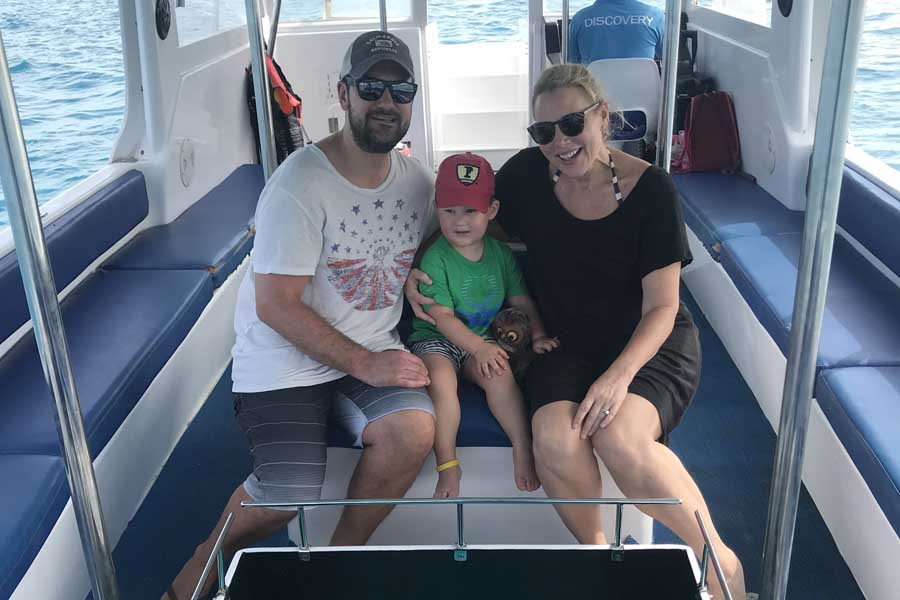 the family on a glass bottom boat tour at club med kani in the maldives