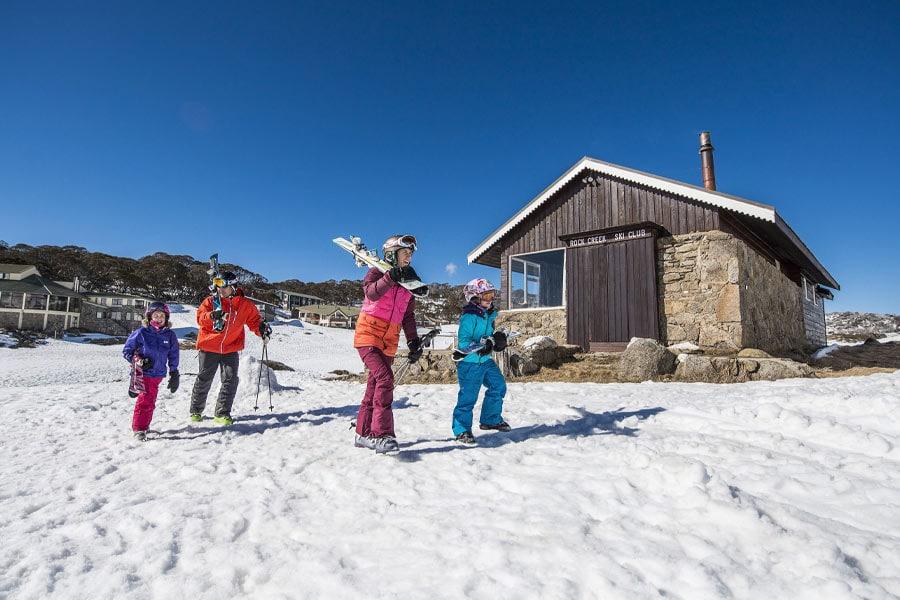 a family at rock creek ski lodge perisher image brett hemmings destination nsw