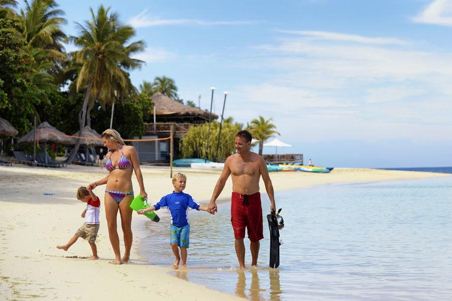 a family walking on beach at castaway resort fiji image mark snyder tourism fiji