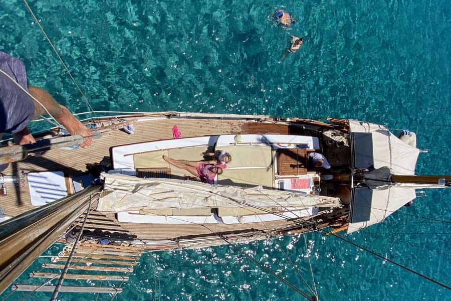 climbing the mast of a clipper while sailing paros