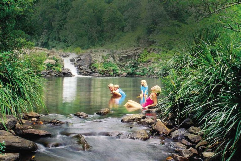 feature a family at gardners falls in the glass house mountains. image tourism and events queensland