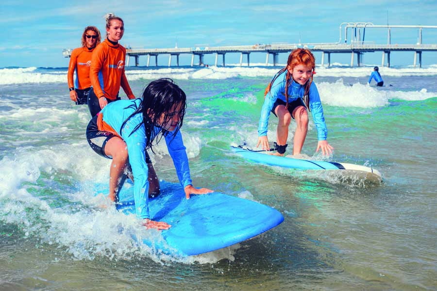 learn to ride waves with get wet surf school