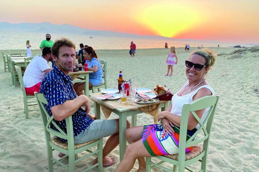mum and dad enjoying the sunset at paradiso on naxos