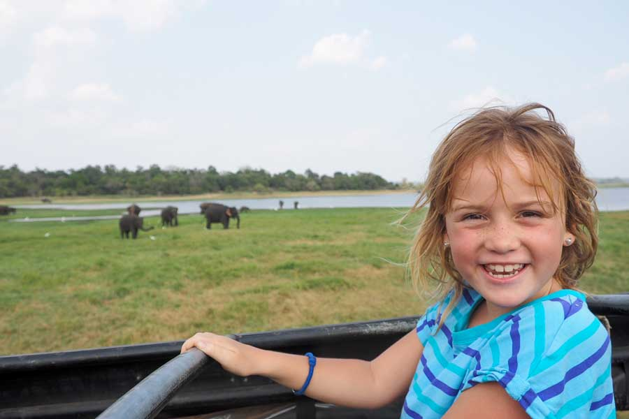 the face of a child seeing her first wild elephants