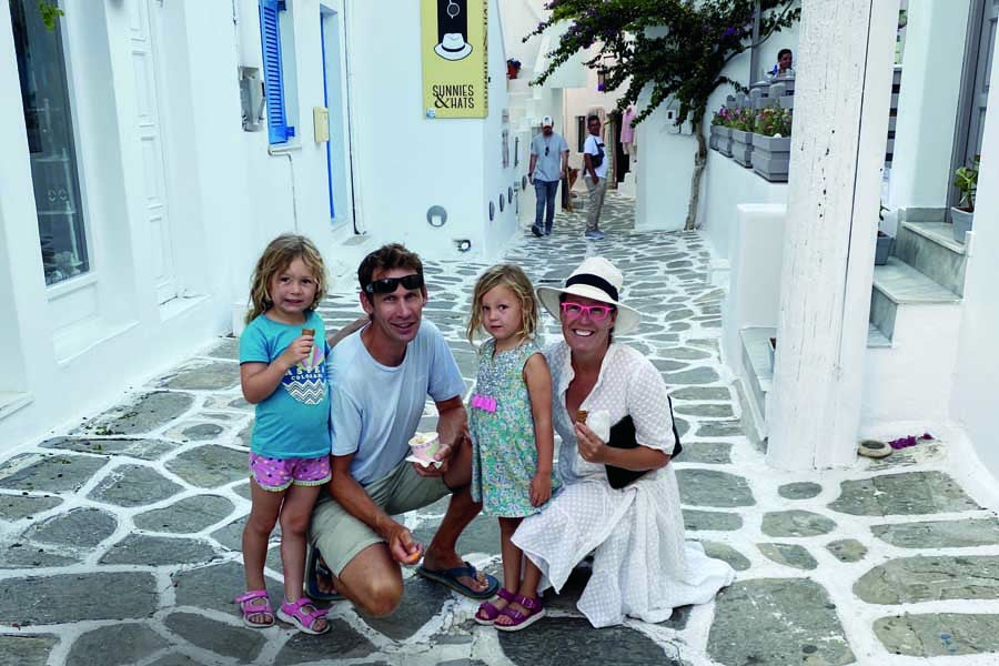 the family in the alleys of naoussa in paros