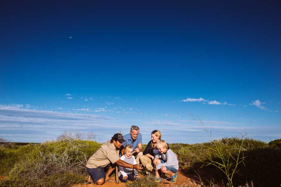 a family on an indigenous tour at monkey mia. image tourism western australia
