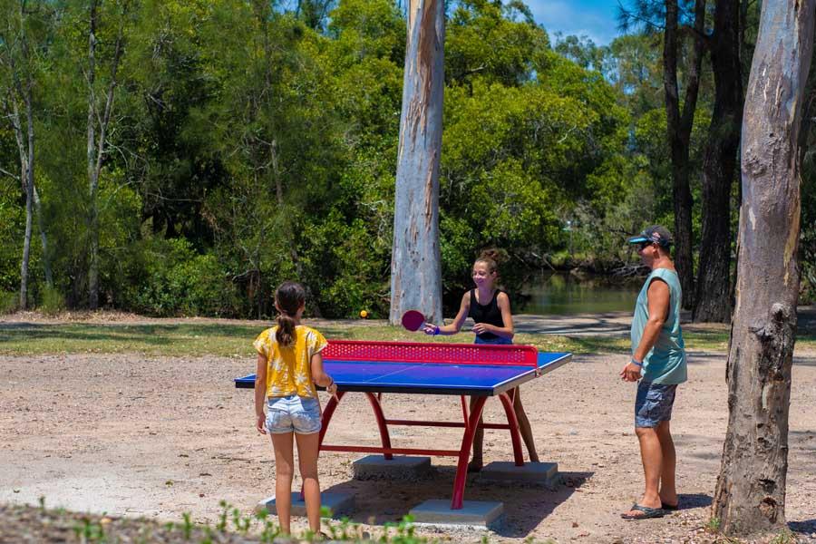 a family playing ping pong at big4 gold coast holiday park