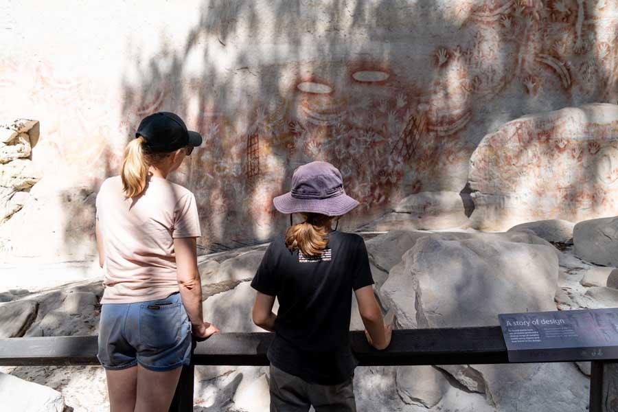 children admiring indigenous rock art at carnarvon gorge in queensland - travel with kids