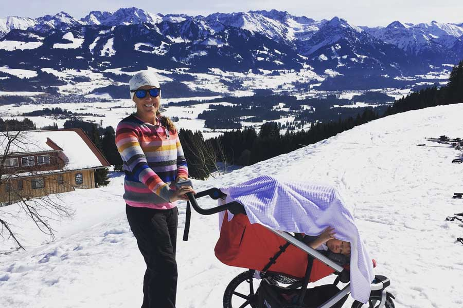 flip byrnes pushing the snow pram at allgauer berghof in germany - Why you should travel with kids