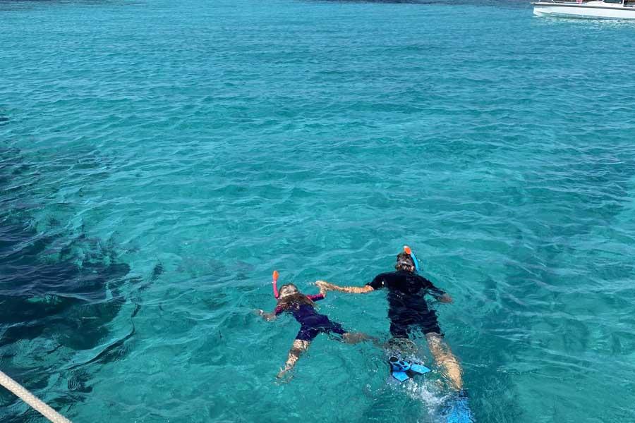 flips daughter lotte snorkelling with her dad in the greek islands. image flip byrnes