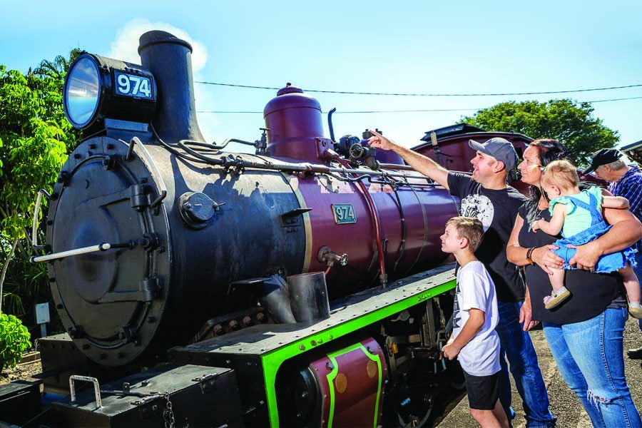 a family admiring the mary valley rattler