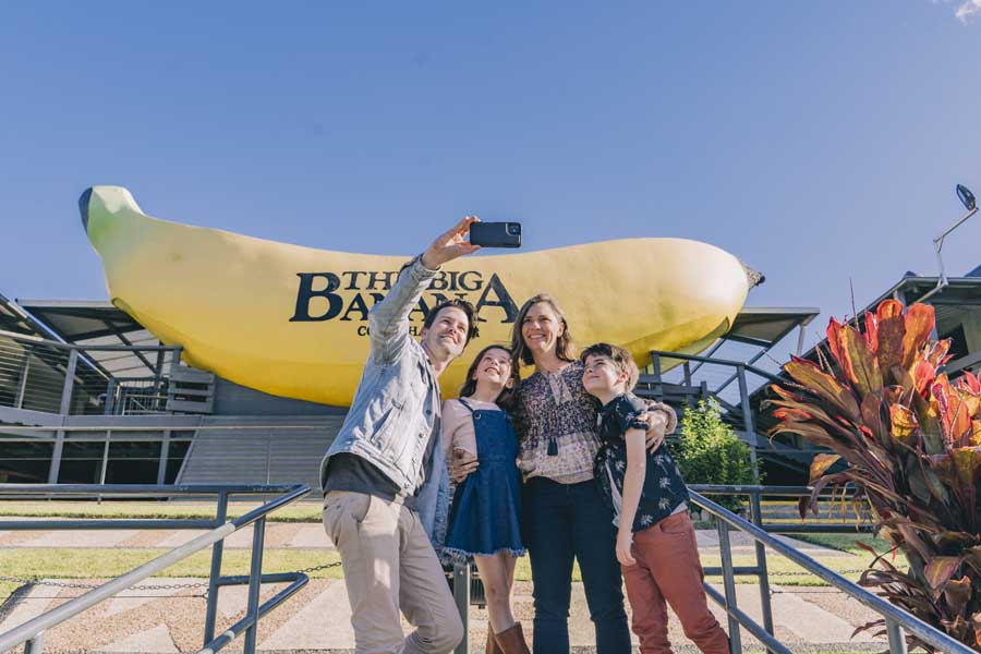 a family taking a selfie at the big banana. image destination nsw