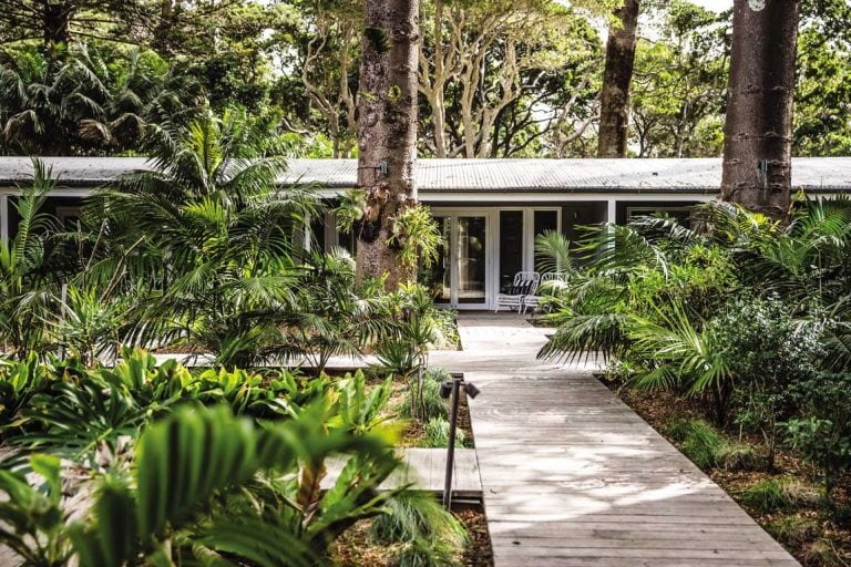 feature a boardwalk leading to rooms at pinetrees lodge. image nikki to