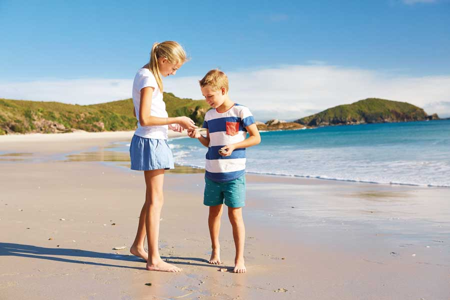 kids on the beach at great keppel island. image tourism and events queensland