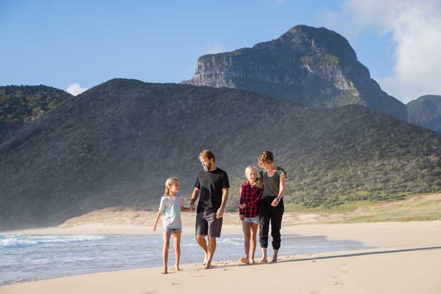 pixie luke elsie and dani walking along the beach on lord howe island. image nikki to