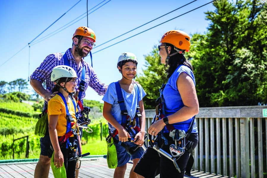 a family preparing to go ziplining on waiheke island