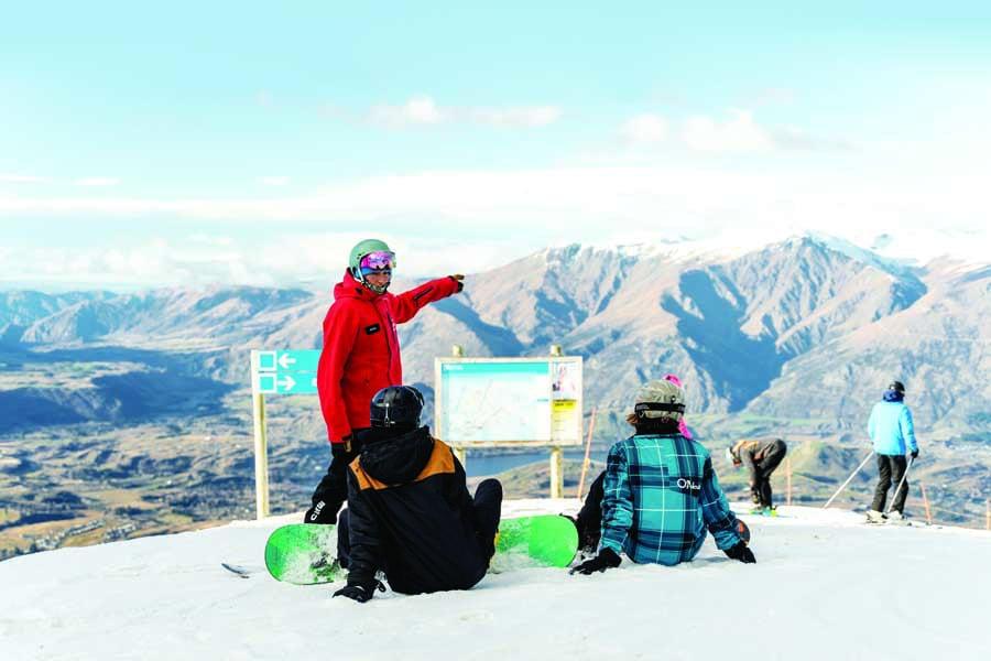 a snowboard lesson at coronet peak, new zealand