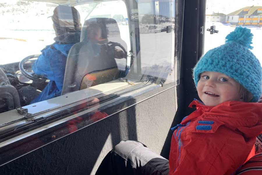 a very happy oliver in the snowcat Perisher ski resort