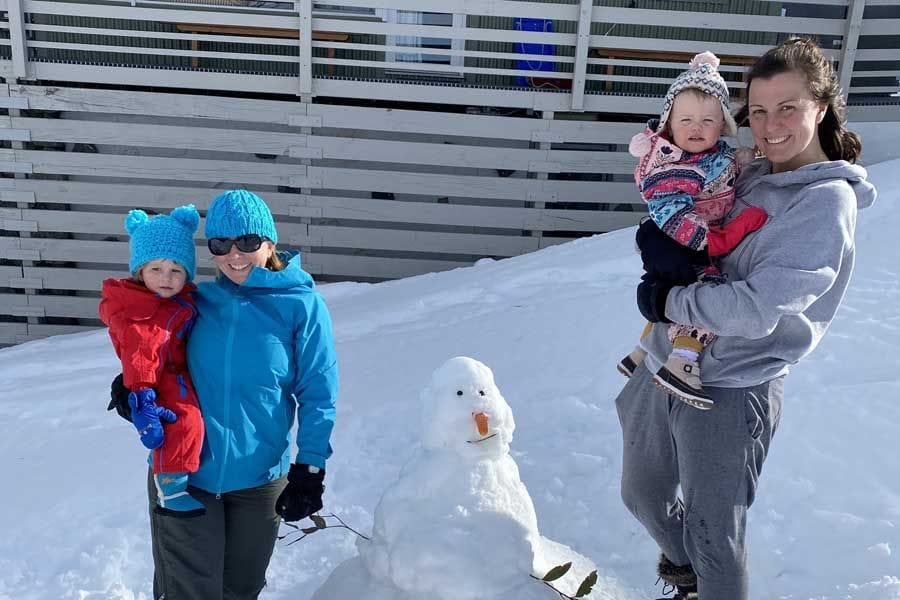angela and oliver with rosie and bella out the front of yalara alpine ski lodge at Perisher ski resort