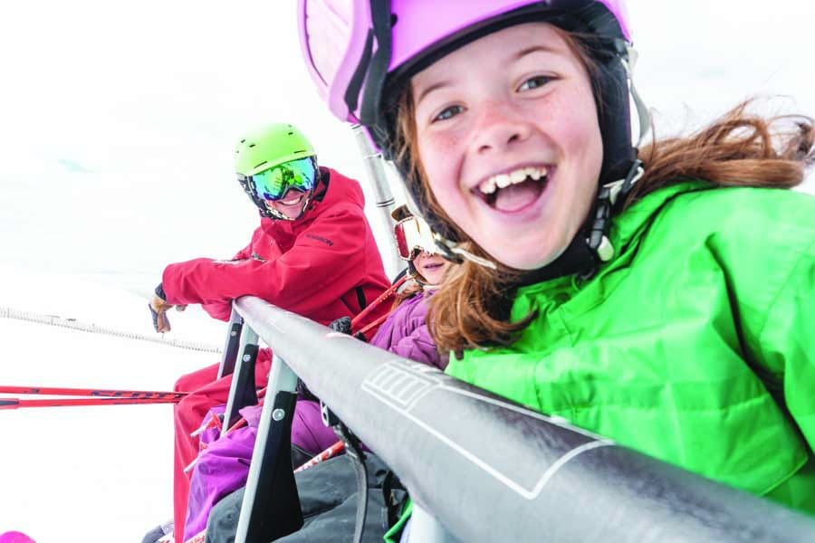 riding the chairlift at cardrona alpine resort, new zealand