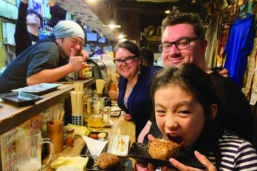 sally with her husband and lyann at hinotetsu yakitori restaurant in nagoya - best places to visit in Japan with kids