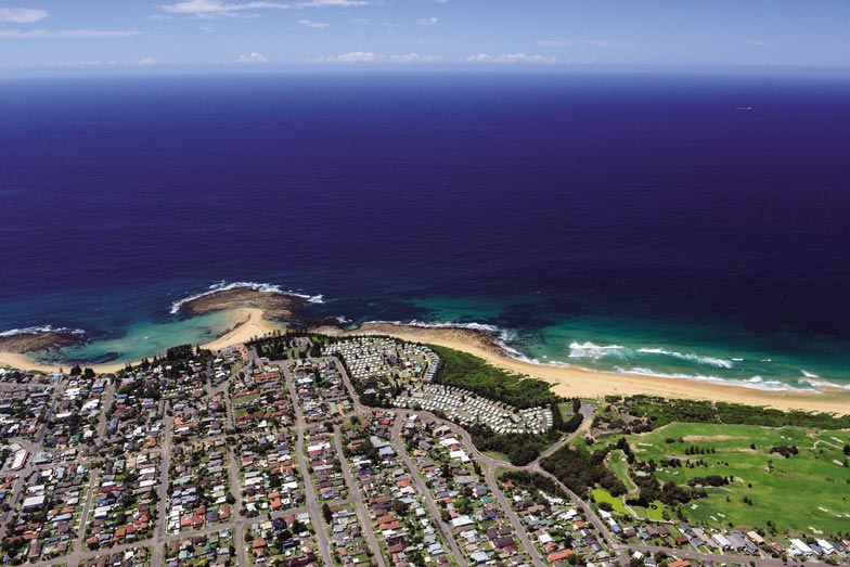 an aerial view of toowoon bay holiday park