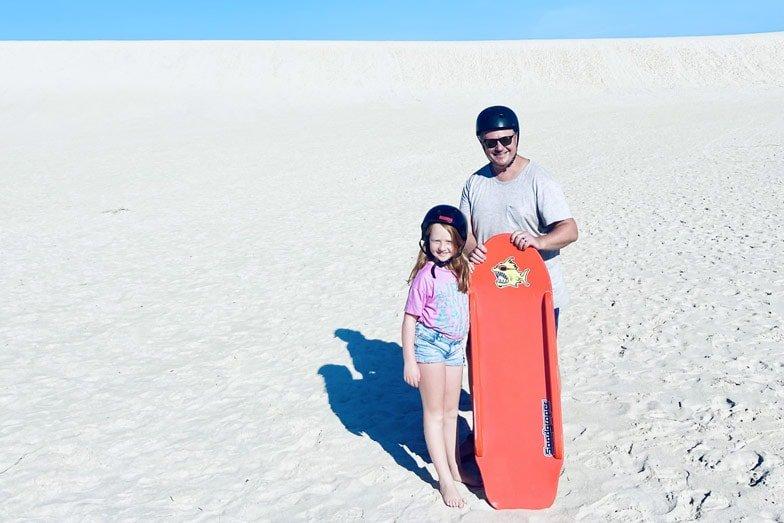 dad and daisy sandboarding on kangaroo island. image meg law