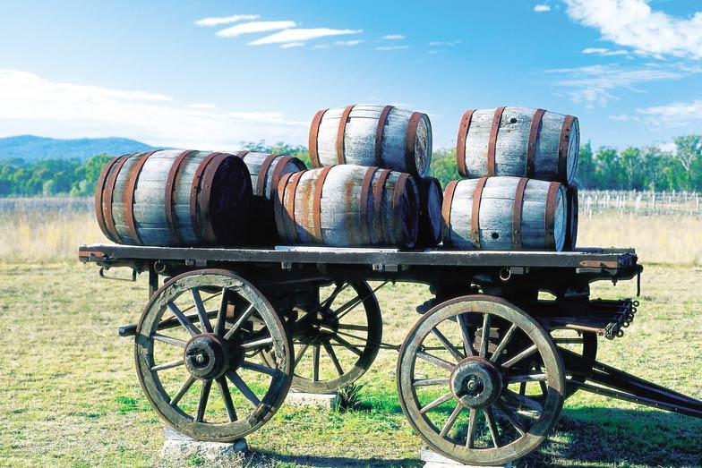 A cart carrying wine barrels in Queenslands Granite Belt with kids