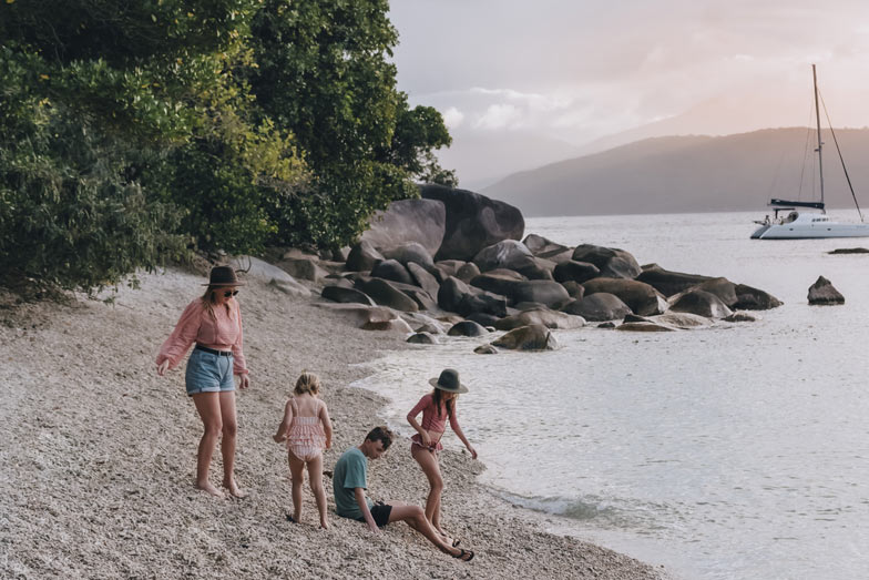 A family playing on Nudey Beach on Fitzroy Island.